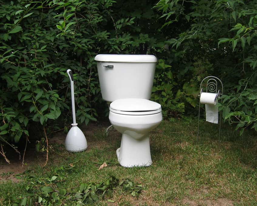 A bathroom set up in the woods