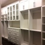 Master's closet organizer with glass doors. Kitchener Waterloo.
