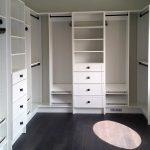 White closet with bronze hardware
