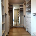 Master`s closet with mirrored doors